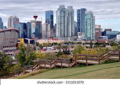 Calgary city skyline with skyscrapers and the the Saddledome, famous Calgary Stampede venue in foreground. Calgary, Alberta Canada. September 2019.