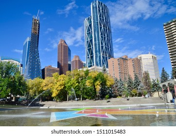 Calgary City skyline with trees with public park and water fountains in foreground. Sept 2019. Calgary, Alberta Canada.