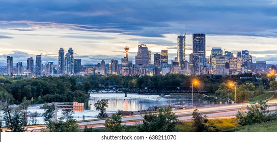 Calgary downtown in the evening at sunset with Bow River