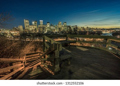 Calgary downtown at night with woody stairs at foreground, Canada
