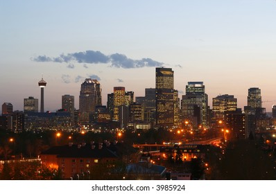 Calgary downtown skyline in the evening at sunset with lights shining from office windows