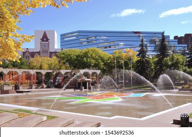 Calgary public park, Olympic Plaza,  with glass offices in background and water fountains in foreground. Calgary, Canada. September 2019