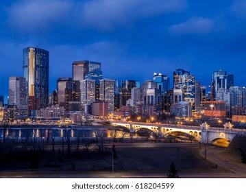 Calgary skyline before sunrise along the Bow River.
