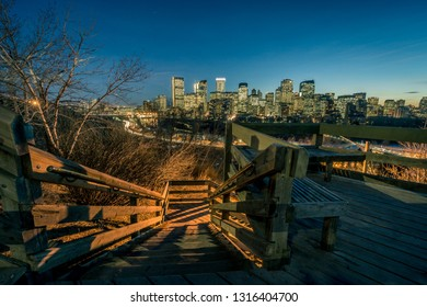 Calgary skyline at night with woody stairs at foreground, Canada