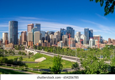 Calgary skyline panorama on a beautiful spring day. Bow river and Centre Street bridge in the foreground.