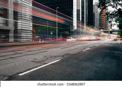 Calgary street at rainy day, Canada. Part of Calgary Downtown, moving lights
