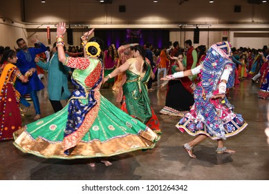 Calgary,Alberta,Canada 10/07/2018 Girls in action enjoying Navratri garba and dandiya dance. A Hindu festival dedicated to the worship of Goddess celebrated by Indian across the world for nine days.