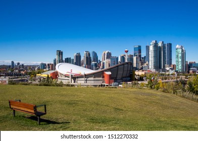 CALGARY,ALBERTA,CANADA-September 22, 2019: A beautiful view of downtown Calgary taken on a sunny autumn day with a bench for sitting in the foreground.