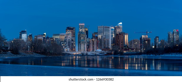 Calgary's skyline along the Bow River during the winter.