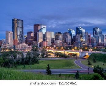 Calgary's skyline along the Bow River at sunset.