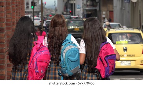 CALI, COLOMBIA FEBRUARY 1 2016: Inner City School Kids With Backpacks Walking To School on February 1 2016 in Cali, Colombia