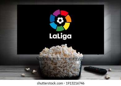 """Cali, Colombia - February 7, 2021: """"La Liga"""" logo on tv screen behind a bowl of popcorn and a remote control."""