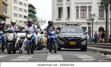 Cali / Colombia - November 2 2017: Motorcycle Cars Road Traffic Waiting At Crosswalk