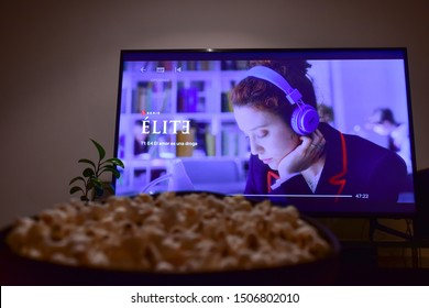 """Cali, Colombia - September 16, 2019: Netflix app on tv screen playing """"Elite"""" behind a bowl of popcorns"""