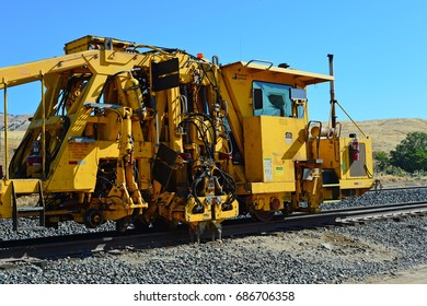 CALIENTE, CA - JULY 29, 2017: Production and switch tamper equipment is in position to begin track repair, replacement and grinding for the road bed.