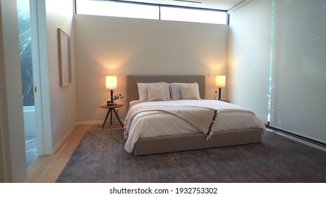 California, 10 March 2021: Luxurious Bright Bedroom With Comfortable King Size Bed and Modern Furniture. Template For Expensive Residential Mansion. Concept For Interior, Architecture And Lifestyle.