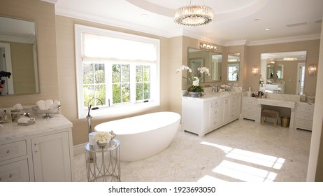 California, 24 February 2021: Luxurious, Spacious And Furnished Bathroom. Modern Template For Elegant And Illuminated Interior. Contemporary Concept For Design, Architecture And Lifestyle.