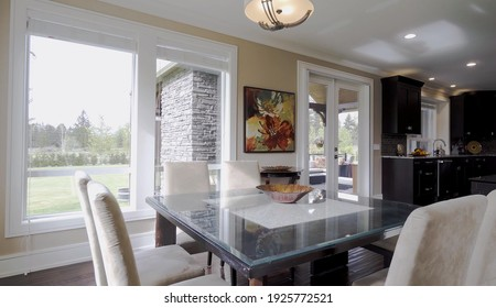 California, 27 February 2021: Luxurious And Bright Dining Room With Contemporary Elements. Elegant Design Of Spacious Estate. Modern Concept For Interior, Architecture, Decoration And Lifestyle.