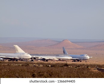 California - August 1, 2011:  commercial airliners planes parked in the Desert.  Large Boeing, McDonnell Douglas, Lockheed, and Airbus aircraft owned by major airlines parked at storage facility.