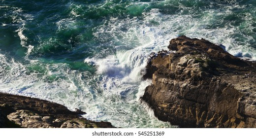 California Coast with crashing ocean waves and rock formations.