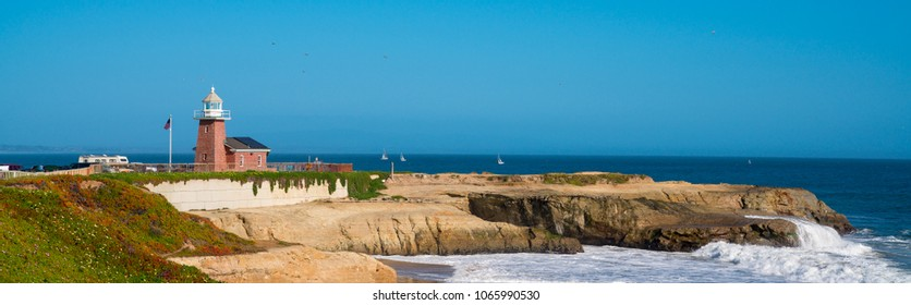 California coastline with a red brick light house