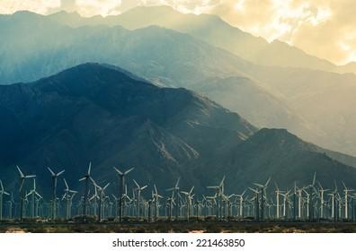 California Desert Wind Turbines in Coachella Valley. Scenic Mountains and Sun Light. California, United States.
