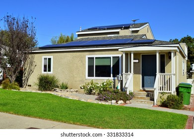 California Dream Houses and estates with a solar panel on the roof. Los Angeles.