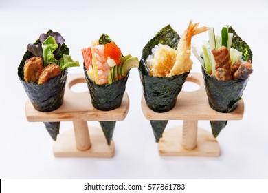 California Hand Roll Sushi Set : Foie Gras, Shrimp with Kani, Tamagoyaki, Avocado and Tobiko. Another is Shrimp Tempura and Crispy Tuna Skin with Sliced Cucumber.
