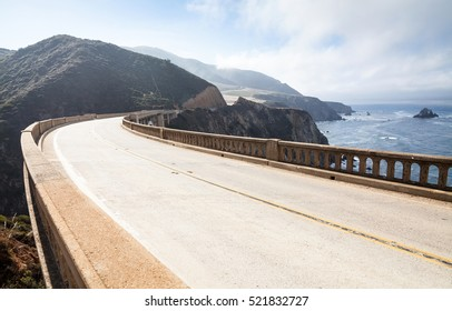 California highway between mountains and pacific ocean. Bixby Bridge at Big Sur