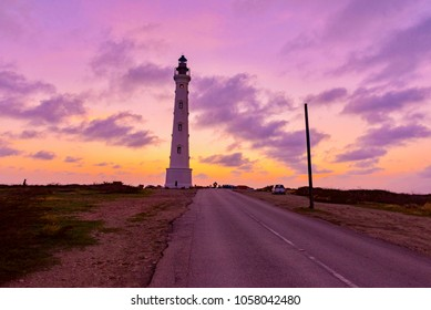 California Lighthouse, at colored sunset in Aruba island in the sea of the caribbean