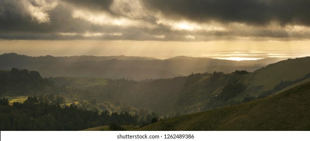 California Santa Cruz Mountains and Pacific Ocean with Sunshine Rays at Sunset