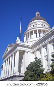 California State Capitol building with the flag at half-mast