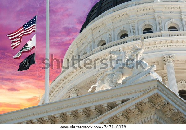 California State Capitol Building Flags and Colorful Sunrise Sky