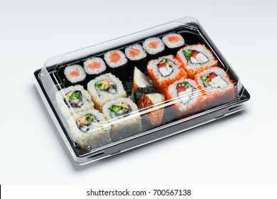 California sushi rolls set in plastic box  close up isolated on a white background. Sushi for take away or sushi delivery in plastic container