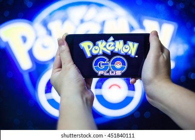California, United State, July 2016 : Hand holding a cellphone to play Pokemon Go with blur background