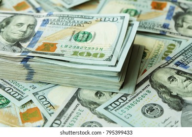 California, USA : 12-August-2017 : A lot of US dollar bank notes are placing on the table in business office in California, USA .