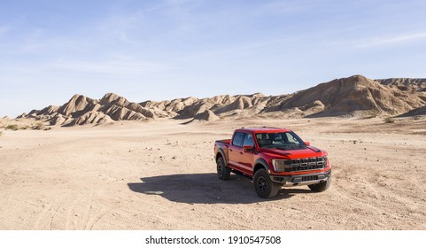 California, USA - January 10, 2021: A red Ford F-150 Raptor is parked in desert