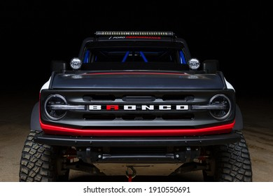 California, USA - January 10, 2021: A Ford Bronco 4600 Race Truck is parked in wild place in twilight