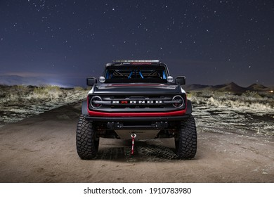 California, USA - January 10, 2021: A Ford Bronco 4600 Race Truck is parked in wild place in night