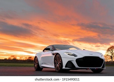 California, USA - January 10, 2021: A white Aston Martin DBS Superleggera Concorde Edition hypercar is parked on road at sunset