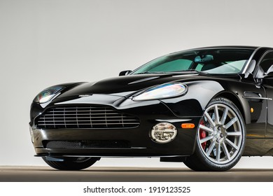 California, USA - January 10, 2021: A new black Aston Martin V12 Vanquish S sport car is parked in showroom