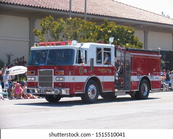 CALIFORNIA, USA - May 2005: On the street parade. Red and white transport vehicle, especially firemen truck.