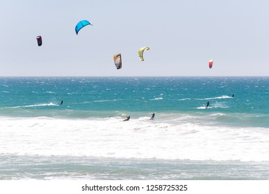 California / USA - May 9 2018: Kiters in the water on the west coast of  USA. A group of kiters in the water. Action sport and adrenaline concept.