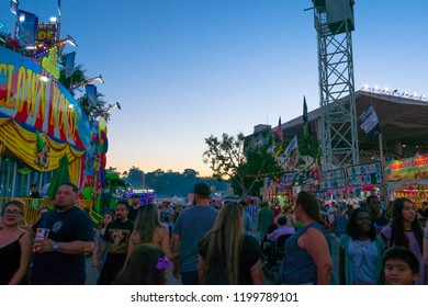 California, USA - September 23rd, 2018. Many people come to LA County fair that takes place in Pomona, CA. The street is filled with crowd of people who are enjoying, walking and eating in the fair.