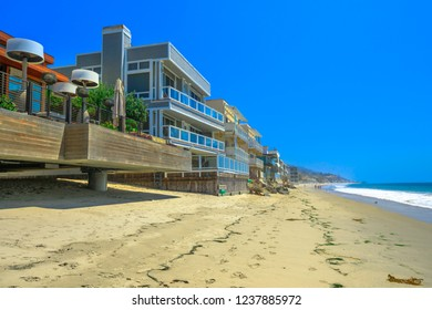 California West Coast. Malibu beach houses on popular Carbon Beach also called Billionaire Beach for the many houses of famous people. Malibu shoreline landscape in a summers sunny day.