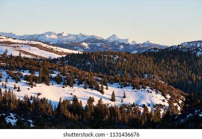 California's Sierra Nevada Mountains Covered in Snow at Sunset