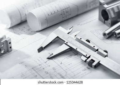 caliper and machine parts on mechanical blueprint
