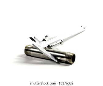 caliper sizing a stainless steel pipe on white background