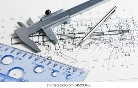 calipers on the background of mechanical drawing