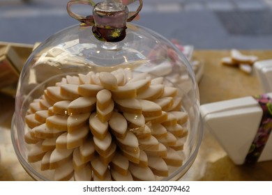 Calissons displayed in a glass cake stand in a candy shop in Aix en Provence, France.